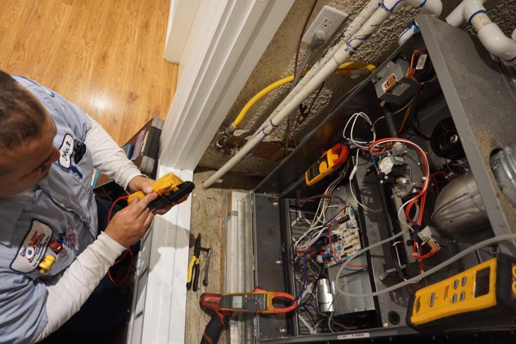 A technician inspecting a furnace