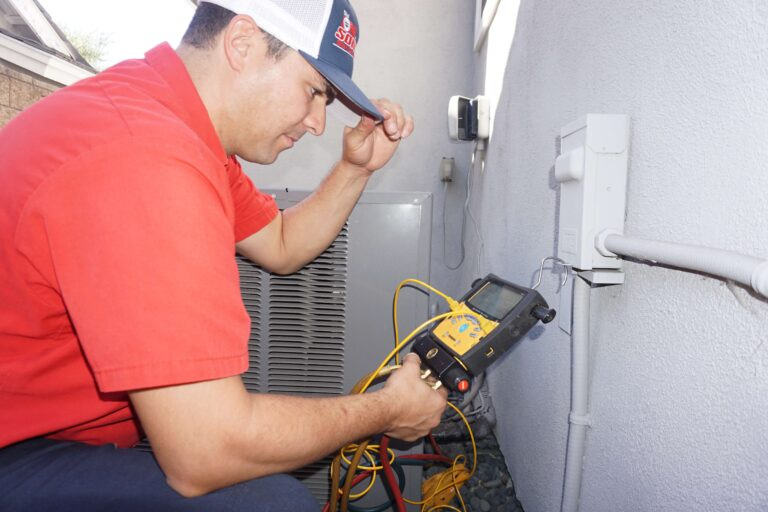 A technician checking refrigerant levels